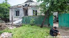 2440273 05/29/2014 An old man outside the debris of his house destroyed in a clash with Ukrainian security forces in Chervoniy Molochar not far from Sloviansk. Andrey Stenin/RIA Novosti
