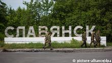 2436761 05/24/2014 Self-defense fighters at the entrance to the town of Slavyansk. Andrey Stenin/RIA Novosti