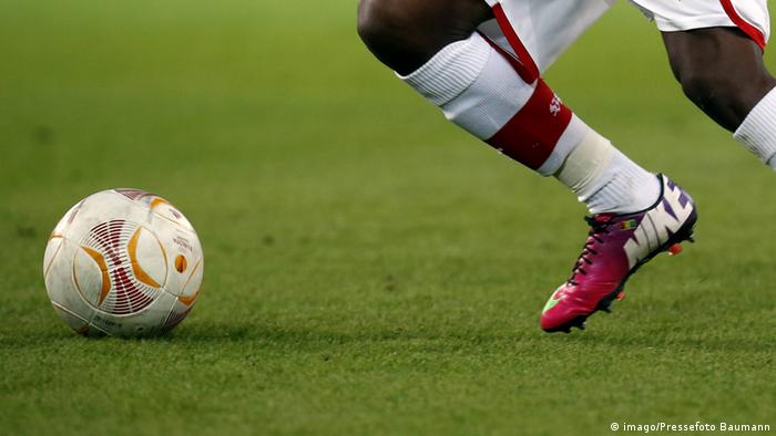 A soccer Player wearing Nike shoes