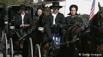 Amish people riding in buggies (Getty Images)