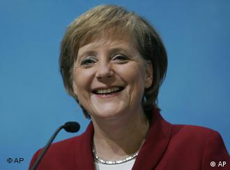 Merkel can finally relax into a real happy smile