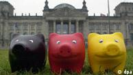 Three pigs painted in Germany's colors