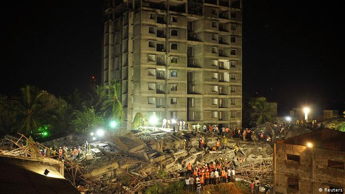 Rescue workers conduct a search operation for survivors at the site of a collapsed 11-story building that was under construction on the outskirts of the southern Indian city of Chennai June 28, 2014. REUTERS/Babu