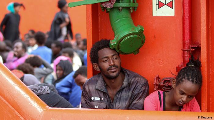 Migrants wait aboard a navy ship before being disembarked in the Sicilian harbour of Augusta June 1, 2014. REUTERS/Antonio Parrinello )