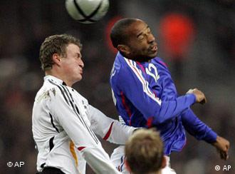 Robert Huth, left, fights for the ball against Thierry Henry
