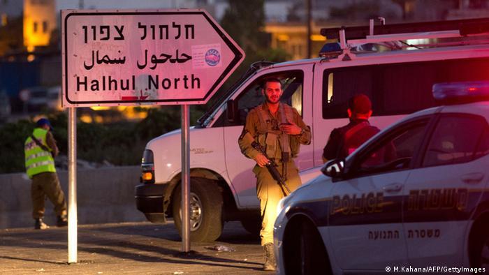 Israelische Sicherheitskräfte nach dem Fund der Leichen der vermissten israelischen Jugendlichen (foto: Getty Images)