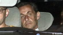 Former French President Nicolas Sarkozy arrives with police by car at the financial investigation unit in Paris to be presented to a judge late July 1, 2014. Former French President Sarkozy was held for questioning for 15 hours on Tuesday over suspicions he used his influence to secure leaked details of an inquiry into alleged irregularities in his 2007 election campaign. REUTERS/Pascal Rossignol (FRANCE - Tags: POLITICS CRIME LAW TPX IMAGES OF THE DAY)