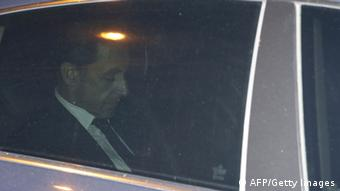 Nicolas Sarkozy in a car