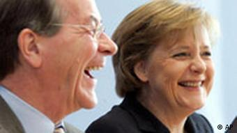 Müntefering and Merkel laughing