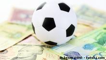 Symbolbild football and money soccer betty concept. #65446921