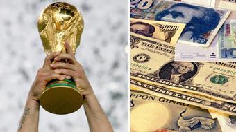 Кубок чемпиона мира по футболу и денежные банкноты