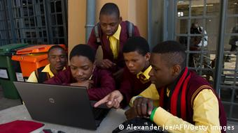 Afrikan students playing on a computer