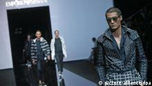 Men in black-and-white jackets at the Emporio Armani fashion show, summer collektion 2015