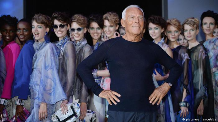Giorgio Armani with the models at Milan Fashion Week in 2013