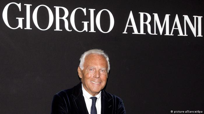 Giorgio Armani posing in 2013 in front of the logo of his design house. (Photo: EPA/CLAUDIO PERI)