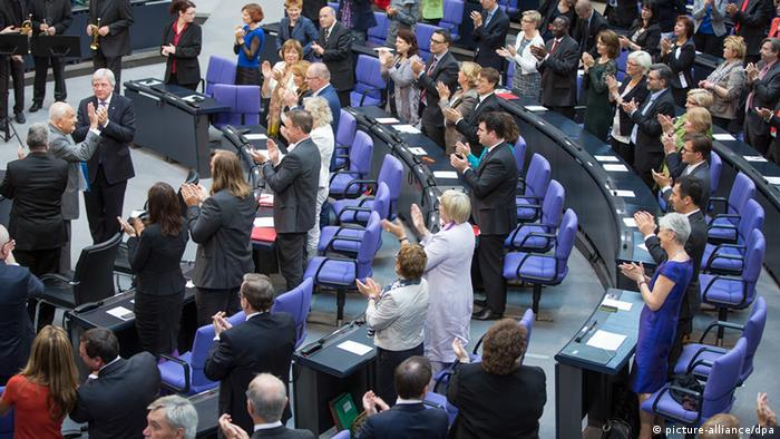 German lawmakers stand and applaud