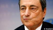 European Central Bank (ECB) President Mario Draghi reacts during the bank's monthly news conference in Frankfurt July 3, 2014. The European Central Bank left interest rates unchanged at record lows on Thursday, holding fire while it assesses the impact of a barrage of measures launched last month to pep up the flagging euro zone economy. REUTERS/Ralph Orlowski (GERMANY - Tags: BUSINESS POLITICS)