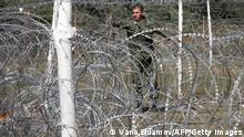 A Russian soldier adjusts razor wire in Karaleti on September 12, 2008. President Dmitry Medvedev on September 12 likened the Georgian assault on South Ossetia that sparked last month's war to the September 11, 2001 attacks on the United States. 'Almost immediately after these events it occured to me that for Russia, August 8, 2008 was almost like September 11, 2001 in the United States,' Medvedev told a high-profile group of Western foreign policy experts in Moscow. 'There were many useful lessons from 9/11 in the United States. I would like the world to draw its own lessons from what happened' in August, he said, adding: 'The world changed.' AFP PHOTO / VANO SHLAMOV (Photo credit should read VANO SHLAMOV/AFP/Getty Images)