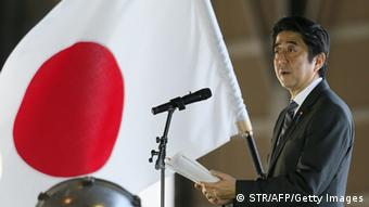 Japanese Prime Minister Shinzo Abe delivers a speech upon his arrival at Naha air base in Japan's southern island of Okinawa on February 2, 2013 for the first visit to Okinawa since becoming premier in December.