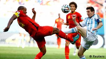 Belgium defender tries to steal the ball off Lionel Messi