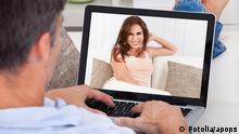 Close-up Of A Man Chatting With Woman Using Laptop