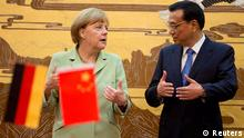 German Chancellor Angela Merkel (L) speaks as Chinese Premier Li Keqiang looks on during their joint news conference at the Great Hall of the People in Beijing July 7, 2014. REUTERS/Andy Wong/Pool (CHINA - Tags: POLITICS)