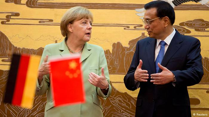 German Chancellor Angela Merkel (L) speaks as Chinese Premier Li Keqiang looks on during their joint news conference at the Great Hall of the People in Beijing July 7, 2014. REUTERS/Andy Wong/Pool