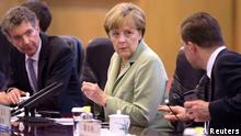 German Chancellor Angela Merkel (C) chats with her delegates as she attends a bilateral meeting with Chinese Premier Li Keqiang (not pictured) at the Great Hall of the People in Beijing July 7, 2014. REUTERS/Andy Wong/Pool (CHINA - Tags: POLITICS)