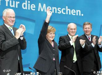 Merkel waves to the party faithful