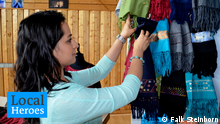 Zohra is organizing the colorful scarves Afghan women have stitched. Copyright: F. Steinborn