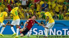 James RODRIGUEZ (COL) faellt nach Foulspuiel durch RAMIRES (BRA) auf den Rasen, rechts FERNANDINHO (BRA), Aktion, Foul, Brasilien BRA - Kolumbien COL 2:1, Viertelfinale am 04.07.2014 in Fortaleza, Fussball Weltmeisterschaft 2014 in Brasilien vom 12.06. - 13.07.2014.