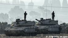 Israeli soldiers stand on Merkava tanks in an army deployment area near Israel's border with the Gaza Strip on July 8, 2014. Israeli warplanes pounded Gaza with more than 50 strikes overnight after Hamas militants fired scores of rockets over the border, dragging the two sides towards a major conflict. AFP PHOTO/JACK GUEZ (Photo credit should read JACK GUEZ/AFP/Getty Images)