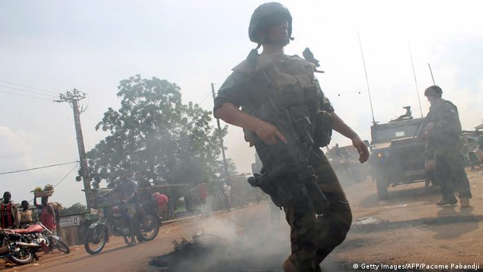 French soldiers of the Sangaris Operation stand guard as people hold a protest against a disarmament operation of anti-balakas militias (photo: PACOME PABANDJI/AFP/Getty Images)