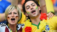 BELO HORIZONTE, BRAZIL - JULY 08: Germany and Brazil fans enjoy the atmosphere prior to the 2014 FIFA World Cup Brazil Semi Final match between Brazil and Germany at Estadio Mineirao on July 8, 2014 in Belo Horizonte, Brazil. (Photo by Laurence Griffiths/Getty Images)