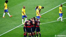 Germany's Sami Khedira celebrates with temamates scoring against Brazil during their 2014 World Cup semi-finals at the Mineirao stadium in Belo Horizonte July 8, 2014. REUTERS/Leonhard Foeger (BRAZIL - Tags: SOCCER SPORT WORLD CUP TPX IMAGES OF THE DAY)