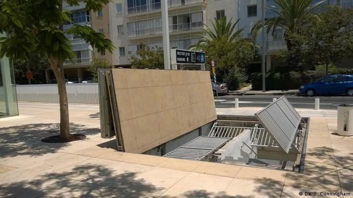 Trapdoor that leads to Tel Aviv parking garage that doubles as bomb shelter (Photo: Blair Cunningham)