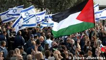 Palestinians during a demonstration in the Hebrew University in Jerusalem on 29 December 2008, protesting Israel's military actions in the Gaza Strip. The demonstrators held signs reading 'Free Gaza' and 'Free Palestine' and waved Palestinian flags and were countered by an Israeli's flag-waving demonstration in suport of what Israel is calling 'Operation Cast Lead,' which Israeli Defense Minister Ehud Barak on 29 december 2008 called an all-out war against Hamas. EPA/KOBI GIDEON ISRAEL OUT . +++(c) dpa - Report+++