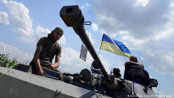 Ukrainian government soldiers sit atop an armoured vehicle as they take up a position around 20 Km south of Donetsk on July 10, 2014. AFP DOMINIQUE FAGET/AFP/Getty Images