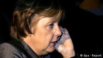 Merkel speaking on a mobile phone