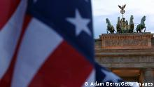 BERLIN, GERMANY - JULY 07: An American flag flies in front of the Brandenburg Gate, near the embassy of the United States of America, on July 7, 2014 in Berlin, Germany. A German employee of his country's foreign-intelligence agency, known as the Bundesnachrichtendienst (BND), was arrested on suspicion of working as a double agent for the United States National Security Agency (NSA), a further blow to German-U.S. relations after suspicions that the latter agency had listened in on German Chancellor Angela Merkel's mobile phone. Investigations into the exact extent of the American government's surveillance in the country are ongoing. Reports from former U.S. intelligence employees have stated that U.S. embassies around the world have contained sophisticated eavesdropping equipment used to gather surveillance on their host countries for decades. (Photo by Adam Berry/Getty Images)