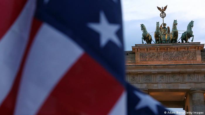 USA flag waves at Brandenburger Gate in Berlin