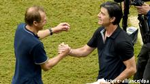 Head coach Juergen Klinsmann (L) of the USA and head coach Joachim Loew of Germany shake hands after the FIFA World Cup group G preliminary round match between the USA and Germany at the Arena Pernambuco in Recife, Brazil, 26 June 2014. Photo: Andreas Gebert/dpa (RESTRICTIONS APPLY: Editorial Use Only, not used in association with any commercial entity - Images must not be used in any form of alert service or push service of any kind including via mobile alert services, downloads to mobile devices or MMS messaging - Images must appear as still images and must not emulate match action video footage - No alteration is made to, and no text or image is superimposed over, any published image which: (a) intentionally obscures or removes a sponsor identification image; or (b) adds or overlays the commercial identification of any third party which is not officially associated with the FIFA World Cup) EDITORIAL USE ONLY