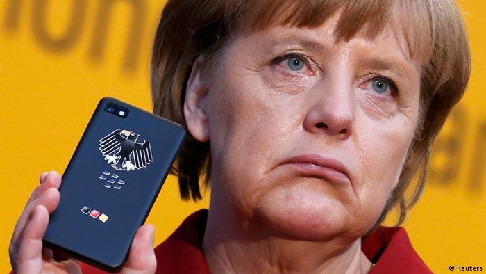 German Chancellor Angela Merkel holding a BlackBerry Z10 smartphone
