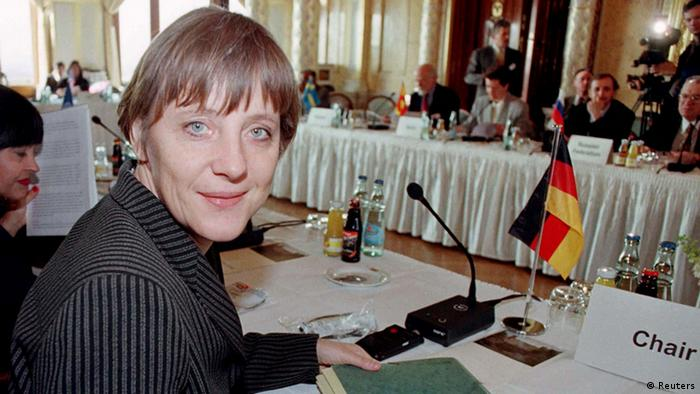 Angela Merkel at a conference in 1997