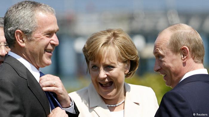 Juli 2014, Merkel u društvu Buša i Putina - tada je napunila 60 godina.