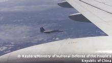 A Japanese F-15 jet (background) and a Chinese Tu-154 jet (foreground) fly over the East China Sea, in this still image from video footage released by China's Ministry of Defense on June 12, 2014. China said on Thursday that Japan's accusations of Chinese fighter jets flying abnormally close to Japanese military aircraft over the East China Sea were aimed at deceiving the international community. Japan protested after Chinese warplanes flew abnormally close to Japanese military aircraft over the East China Sea on Wednesday. REUTERS/Ministry of National Defense of the People's Republic of China/via Reuters TV (EAST CHINA SEA - Tags: TRANSPORT POLITICS MILITARY) ATTENTION EDITORS - THIS PICTURE WAS PROVIDED BY A THIRD PARTY. REUTERS IS UNABLE TO INDEPENDENTLY VERIFY THE AUTHENTICITY, CONTENT, LOCATION OR DATE OF THIS IMAGE. THIS PICTURE IS DISTRIBUTED EXACTLY AS RECEIVED BY REUTERS, AS A SERVICE TO CLIENTS. EDITORIAL USE ONLY. NOT FOR SALE FOR MARKETING OR ADVERTISING CAMPAIGNS. NO SALES. NO ARCHIVES