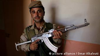 A Kurdish fighter in Iraq holding an automatic rifle Photo by Omar Alkalouti / Pacific Press
