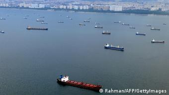 An aerial photo ships anchored along the coastal line off Singapore.