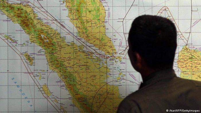 A member of the Indonesian Air Force at Medan city military base inspects the Indonesian military search operation for the missing Malaysian Airlines flight