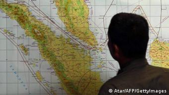 A member of the Indonesian Air Force at Medan city military base inspects the Indonesian military search operation for the missing Malaysian Airlines flight MH370 on March 12, 2014 in the area of Malacca Strait, a sea passageway between Indonesia (seen left of the map) and Malaysia (seen top left of the map) (Photo: ATAR/AFP/Getty Images)